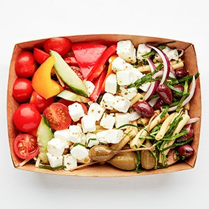 Vegetarian salad with feta cheese. Delivered in a take-away-box. Disposable cutlery and nakpin included.